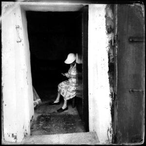 old woman in doorway