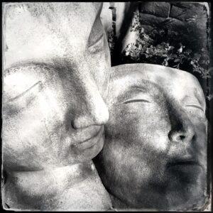 statues, faces