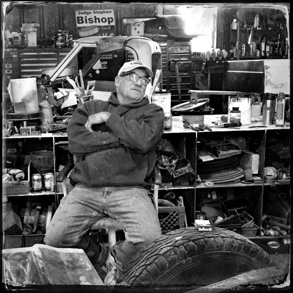 Portrait, man, junk yard