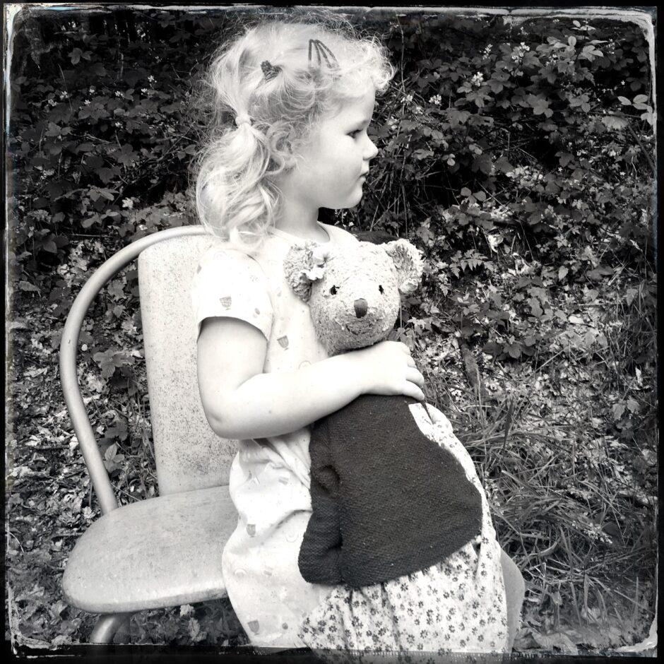 child, stuffed animal